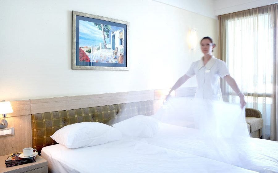 Staff changing sheets of the standard room