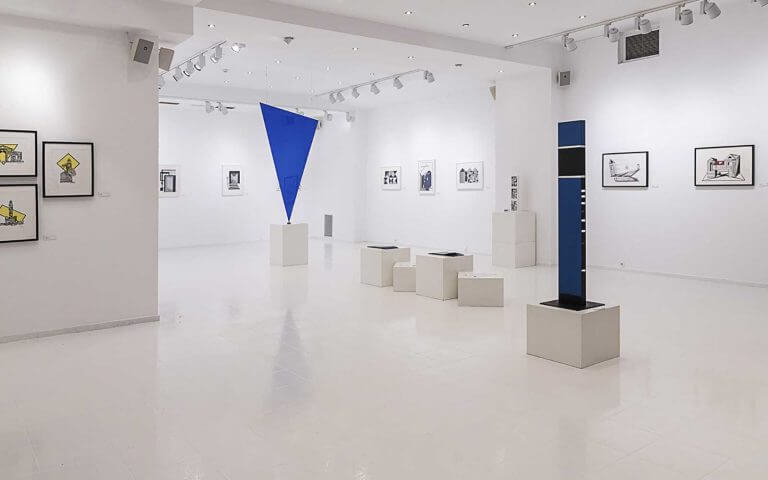 The gallery walls full of modern art pieces