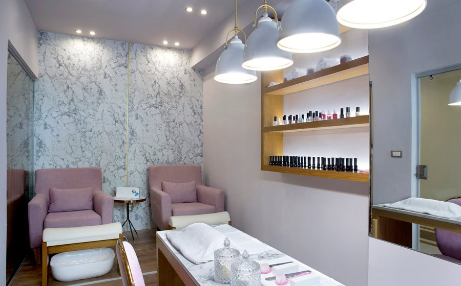 Desk, armchairs and nail health products of spa salon