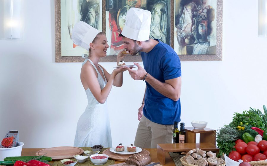 Couple tasting food, cooking lessons
