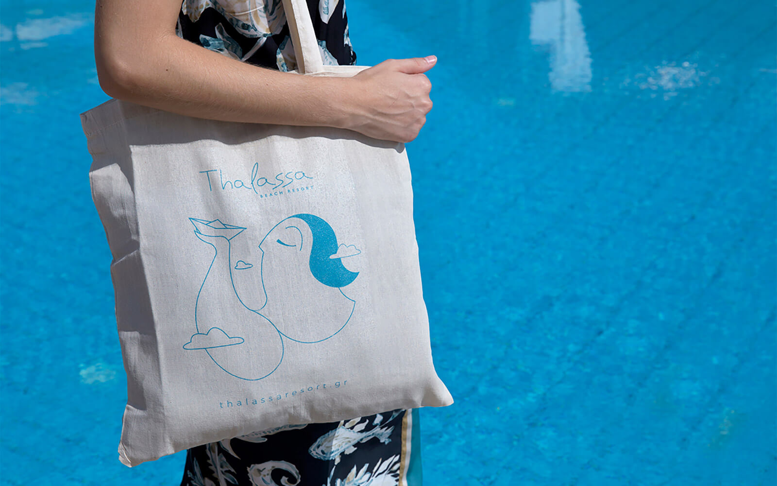 Woman holding bag with thalassa brand