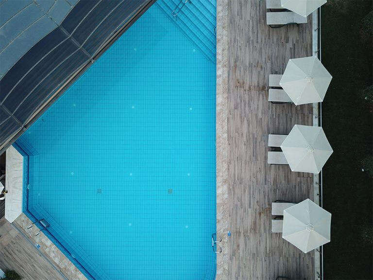 drone view of the pool and sunbeds